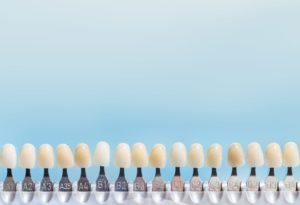 Tooth color guide on a blue background