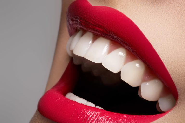 Red lips and white teeth