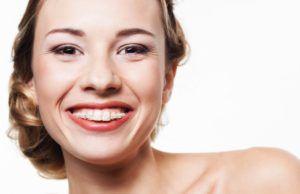 Girl smiling with ceramic braces